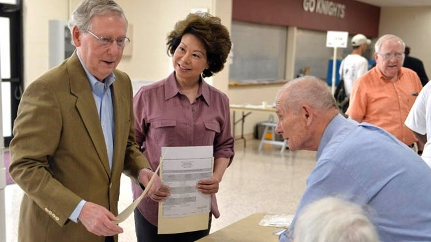 May 20, 2014: Kentucky Republican Senator Mitch McConnell and wife Elaine Chao at a polling station at Bellarmine University, in Louisville, Ky.