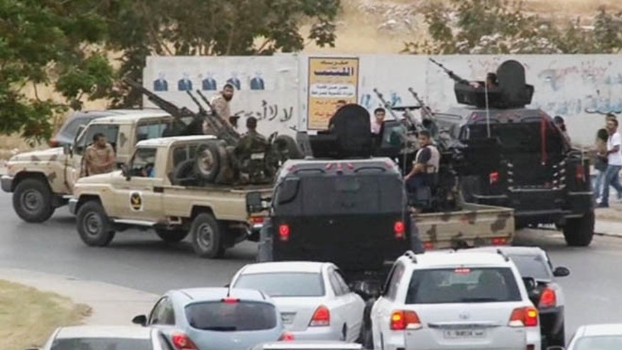 May 18, 2014: In this image made from video provided by the Libyan national army via AP Television, vehicles with heavy artillery of the Tripoli joint security forces move closer to the parliament building in Tripoli, Libya.