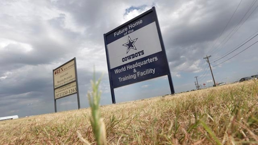 FILE - In this Aug. 13, 2013, file photo, a sign announces the future of the Dallas Cowboys football team headquarters and training facility in Frisco, Texas. New data from the Census Bureau shows that three of the nations five fastest-growing cities are located in the Lone Star State. San Marcos, Frisco and Cedar Park, Texas were No. 1, 2 and 4 in percentage population growth between 2012 and 2013.  (AP Photo/LM Otero, File)