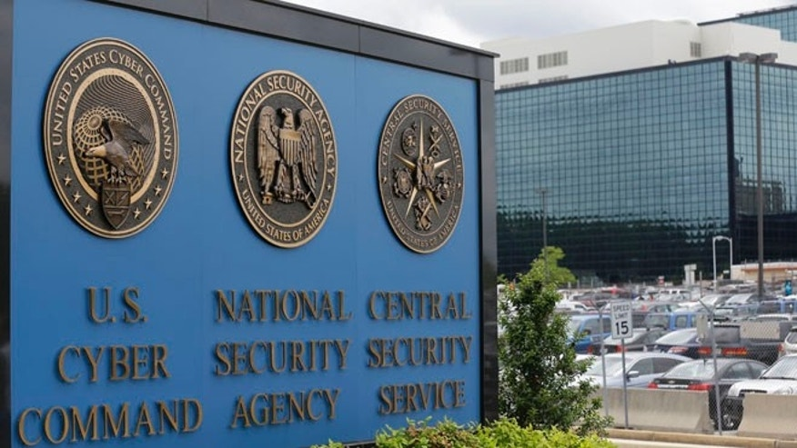This June 6, 2013, file photo shows the sign outside the National Security Agency campus in Fort Meade, Md. A presidential advisory panel has recommended dozens of changes to the government's surveillance programs, including stripping the NSA of its ability to store Americans' telephone records and requiring a court to sign off on the individual searches of phone and Internet data.