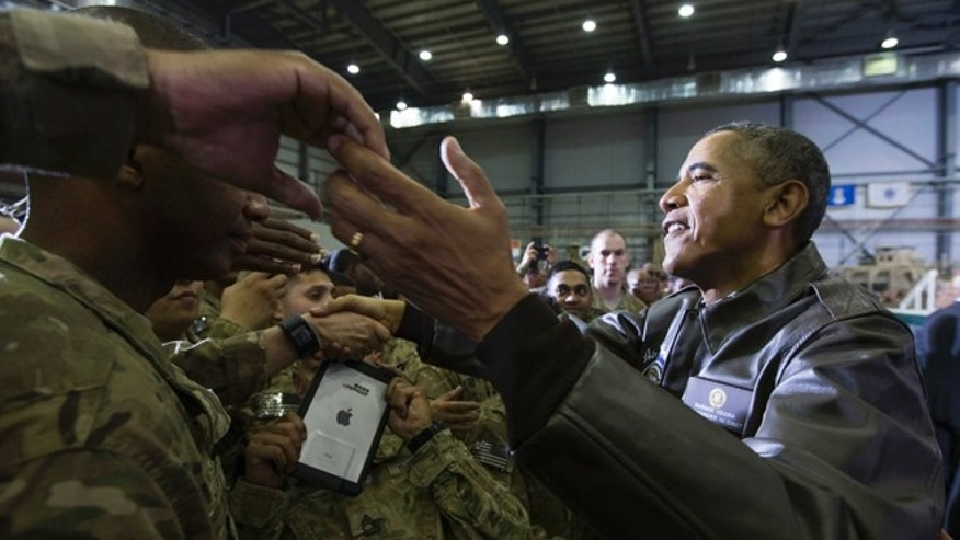 May 25, 2014: President Obama shakes hands at a troop rally at Bagram Air Field, north of Kabul, Afghanistan.