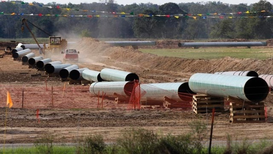 File - In this Oct. 4, 2012 file photo, large sections of pipe are shown in Sumner Texas. (AP Photo/Tony Gutierrez, file)