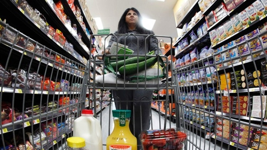 FILE: 2011: A shopper in a Walmart Neighborhood Market in Chicago, Ill.