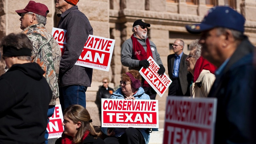 AUSTIN, TX- JANUARY 11:  People belonging to the Tea Party movement convene at a rally at the Texas state capitol during the first day of the 82nd Legislative session on January 11, 2011 in Austin, Texas. The demonstrators picketed demanding true conservative values from elected officials.  (Photo by Ben Sklar/Getty Images)
