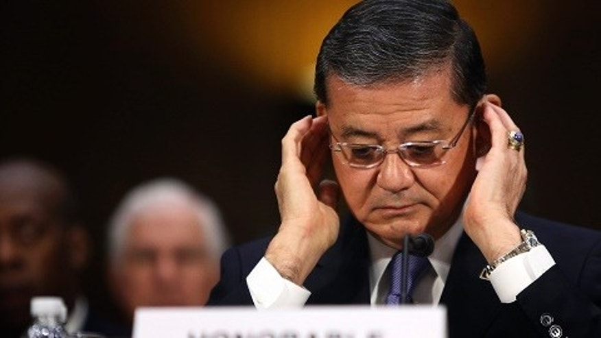U.S. Department of Veterans Affairs Secretary Eric Shinseki adjusts his glasses as he takes his seat to testify before a Senate Veterans Affairs Committee hearing on VA health care, on Capitol Hill in Washington May 15, 2014. REUTERS/Jonathan Ernst    (UNITED STATES - Tags: POLITICS MILITARY HEALTH) - RTR3PBJR