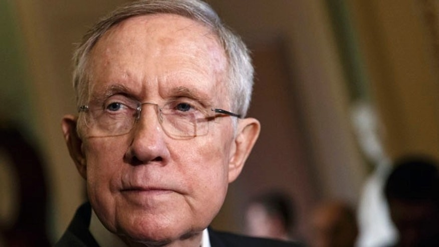 This April 29, 2014 file photo shows Senate Majority Leader Harry Reid of Nev. talking to reporters on Capitol Hill in Washington.