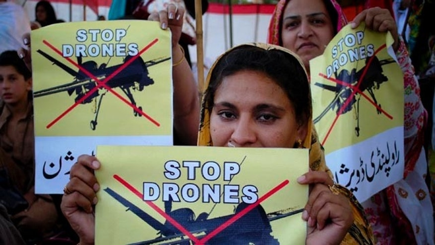FILE - In this April 23, 2011, Pakistan women take part in a rally against the U.S. drone strikes in Pakistani tribal areas in Peshawar, Pakistan. (AP Photo/Mohammad Sajjad, file)