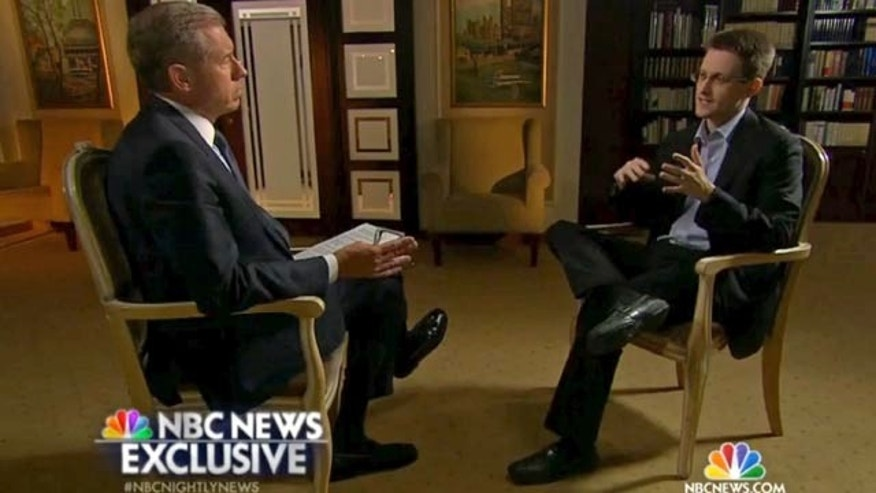 May 27, 2014: In this image taken from video provided by NBC News Edward Snowden, a former National Security Agency (NSA) contractor, right, speaks to NBC News anchor Brian Williams, left, during an NBC Exclusive interview. Snowden told Williams that he worked undercover and overseas for the CIA and the NSA. (AP Photo/NBC News)