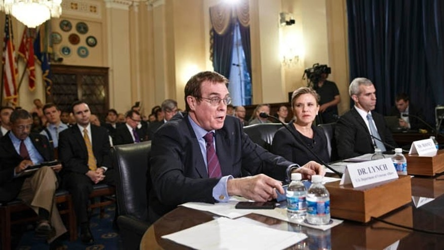 May 28, 2014: From left, Dr. Thomas Lynch, assistant deputy under secretary for health for clinical operations at the Veterans Health Administration; Joan Mooney, the assistant secretary for congressional and legislative affairs at the Department of Veterans Affairs; and Michael Huff, a congressional relations officer with the Department of Veterans Affairs, testify before the House Committee on Veterans Affairs in Washington.