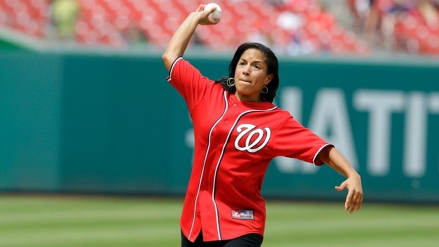 July 27, 2013: National Security Adviser Susan Rice throws out the ceremonial first pitch before a baseball game between the New York Mets and the Washington Nationals at Nationals Park in Washington.