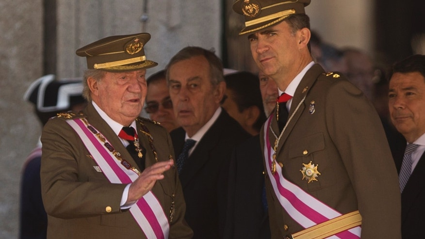 King Juan Carlos and Crown Prince Felipe at a military ceremony outside Madrid, Spain, Tuesday, June 3, 2014.