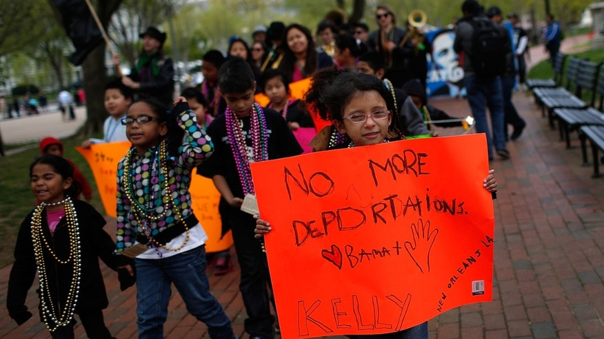 WASHINGTON, DC - APRIL 23:  Children of immigrants march near the White House while calling for immigration reform April 23, 2014 in Washington, DC. About 100 people joined the protest to voice their concerns over the deportation policies of the U.S. government. (Photo by Win McNamee/Getty Images)