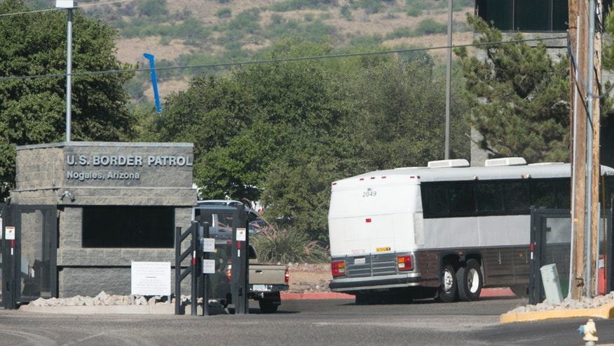 A bus carrying children arrives to a border patrol facility in Nogales, Ariz., Saturday, June 7, 2014.