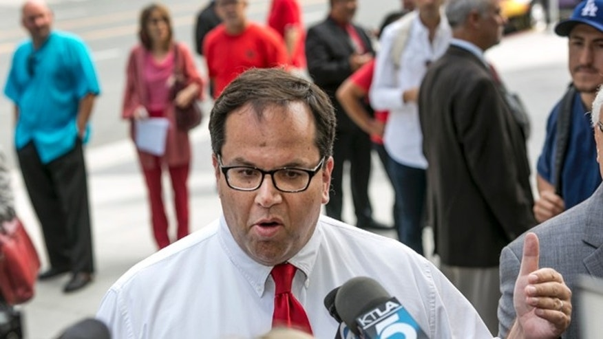 June 10, 2014: Alex Caputo-Pearl, president elect of the United Teachers Los Angeles, UTLA, takes questions on the Vergara v. California lawsuit verdict in Los Angeles.  A judge struck down tenure and other job protections for California's public school teachers as unconstitutional, saying such laws harm students, especially poor and minority ones  by saddling them with bad teachers. (AP Photo/Damian Dovarganes)