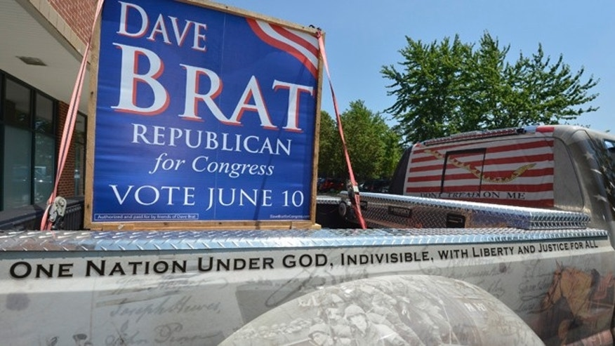 FILE: June 11, 2014: A truck driven by a supporter for Tea Party candidate Dave Brat's campaign in front of his headquarters in Glen Allen, Va.