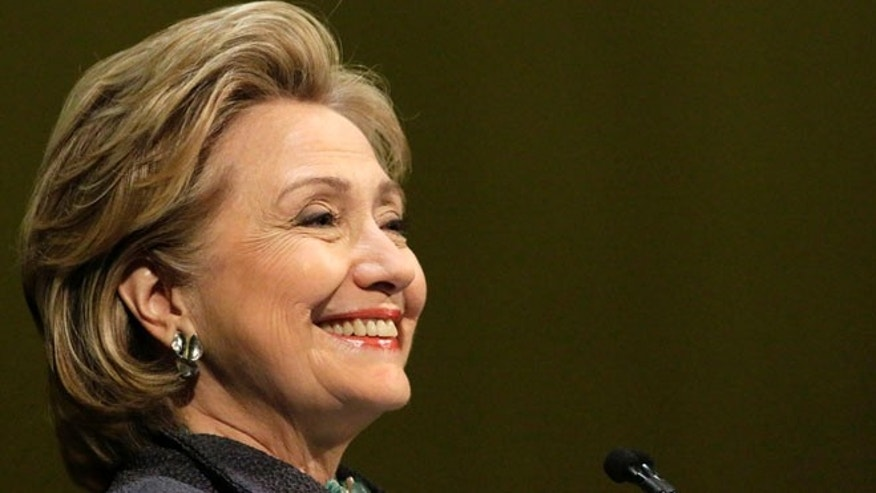 June 11, 2014: Former Secretary of State Hillary Rodham Clinton smiles out to the crowd in Chicago.