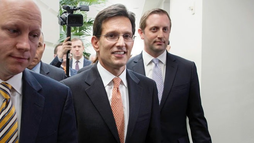House Majority Leader Eric Cantor, R-Va., leaves a news conference after telling reporters he intends to resign his leadership post at the end of July following his defeat in the Virginia primary Tuesday, at the Capitol in Washington, Wednesday, June 11, 2014.
