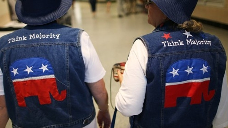 TAMPA, FL - AUGUST 29:  Pat Tippett of Baxley, GA and Linda Dennison of Blackshear, GA wear GOP logo cut-off jean jackets with matching blue hats during the third day of the Republican National Convention at the Tampa Bay Times Forum on August 29, 2012 in Tampa, Florida. Former Massachusetts Gov. Former Massachusetts Gov. Mitt Romney was nominated as the Republican presidential candidate during the RNC, which is scheduled to conclude August 30.  (Photo by Chip Somodevilla/Getty Images)