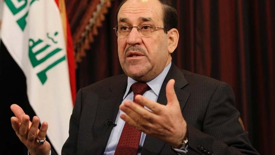 FILE - In this Dec. 3, 2011, file photo, Iraq's Shiite Prime Minister Nouri al-Maliki talks during an interview with The Associated Press in Baghdad, Iraq. (AP Photo/Hadi Mizban, File)