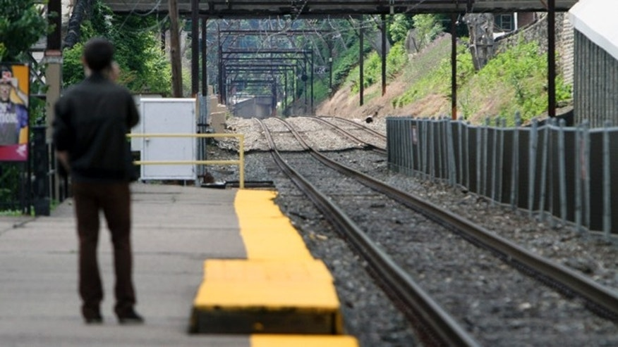 June 14, 2014: Unaware of the work stoppage Roy Pearson waits for a SEPTA commuter train at the East Falls commuter rail station in Philadelphia. (AP)