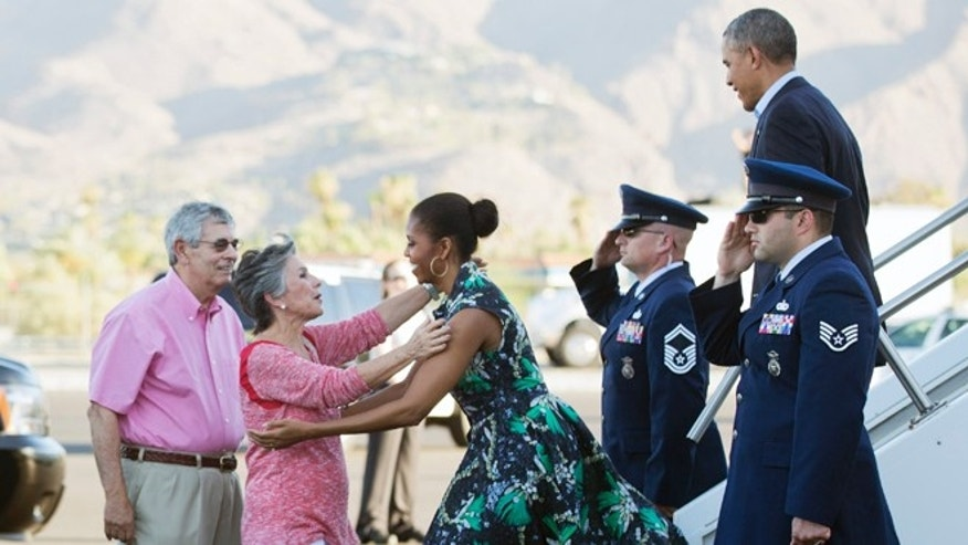 June 13, 2014: President Barack Obama and first lady Michelle Obama, are greeted on the tarmac by Sen. Barbara Boxer, D-Calif., second from left, and her husband Stewart Boxer, left, as they arrive in Palm Springs, Calif.  (AP)