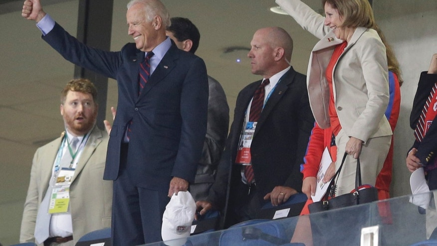 US Vice President Joe Biden, left, gives a thumbs-up after the group G World Cup soccer match between Ghana and the United States at the Arena das Dunas in Natal, Brazil, Monday, June 16, 2014.  The United States won the match 2-1. (AP Photo/Ricardo Mazalan)