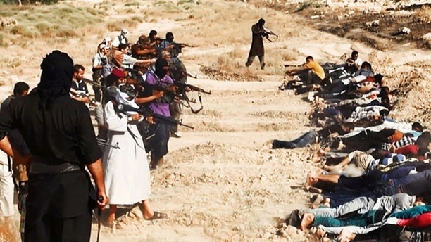 This image posted on a militant website on Saturday, June 14, 2014, which has been verified and is consistent with other AP reporting, appears to show militants from the al-Qaida-inspired Islamic State of Iraq and the Levant (ISIL) taking aim at captured Iraqi soldiers wearing plain clothes after taking over a base in Tikrit, Iraq. The Islamic militant group that seized much of northern Iraq has posted photos that appear to show its fighters shooting dead dozens of captured Iraqi soldiers in a province north of the capital Baghdad. Iraq's top military spokesman Lt. Gen. Qassim al-Moussawi confirmed the photos' authenticity on Sunday and said he was aware of cases of mass murder of Iraqi soldiers. (AP Photo via militant website)