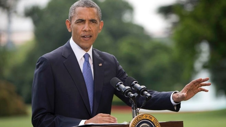 President Barack Obama talks about his administration's response to a growing insurgency foothold in Iraq, Friday, June 13, 2014, on the South Lawn of the White House in Washington.