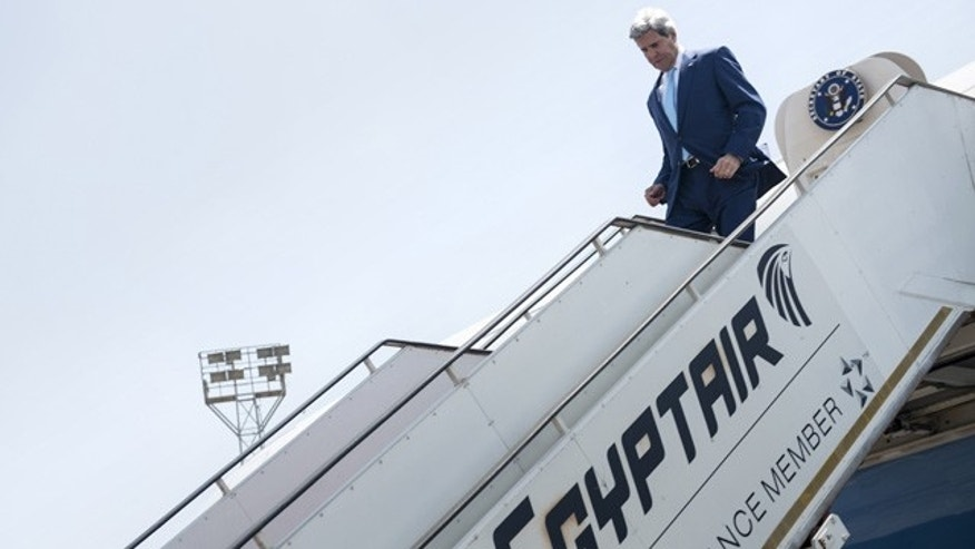 June 22, 2014: U.S. Secretary of State John Kerry disembarks upon his arrival at Cairo International Airport. Kerry arrived Sunday in the Egyptian capital to meet with President Abdel-Fattah el-Sisi in the highest-level American outreach since he took office. (AP Photo/Brendan Smalowski, Pool)