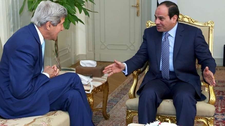 June 22, 2014: In this photo provided by Egypt's state news agency MENA, U.S. Secretary of State John Kerry, left, talks with Egypts President Abdel Fattah el-Sisi before a meeting at the presidential palace in Cairo, Egypt,.