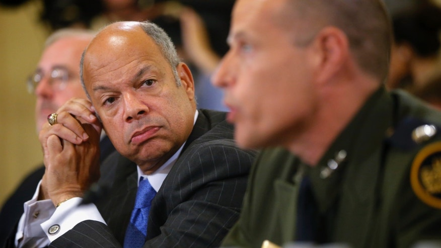 Secretary Johnson listens as Deputy Chief of Border Patrol Ronald D. Vitiello testifies on Capitol Hill, June 24, 2014.