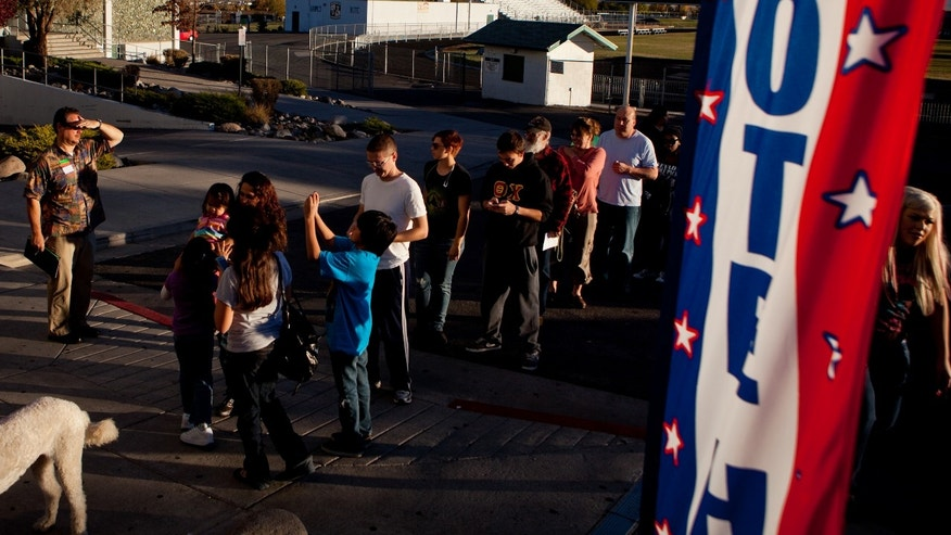 Voters wait in line to cast their ballot at Hug High School on November 6, 2012 in Reno, Nevada.