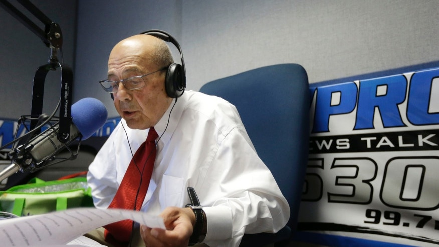 June 25, 2014: Former Providence Mayor Buddy Cianci reads a prepared statement at the WPRO-AM radio station in East Providence, R.I.