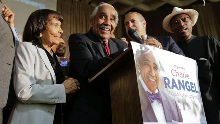 Accompanied by his wife Alma Rangel, left, Rep. Charles Rangel, D-N.Y., speaks at his primary election night gathering, Tuesday, June 24, 2014, in New York.