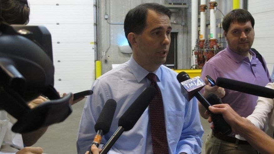 Gov. Scott Walker speaks to reporters in Madison, Wis. on Thursday, June 26, 2014.