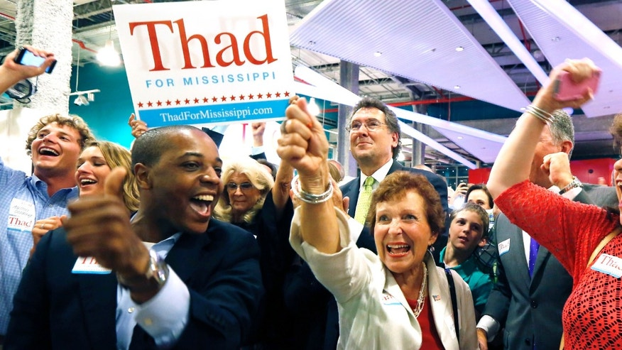 June 24, 2014 - Supporters of Sen. Thad Cochran, R-Miss., break into cheer as he is declared the winner in his primary runoff for the GOP nomination for U.S. Senate at his victory party at the Mississippi Children's Museum in Jackson, Miss.  Cochranâs GOP primary victory, thanks in part to black Mississippians who turned out to vote for him, exemplifies a new math that politicians of all persuasions may be forced to learn as this countryâs voting population slowly changes complexion. (AP Photo/Rogelio V. Solis, File)