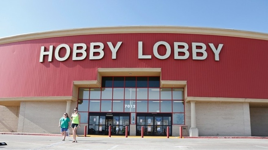 Customers leave a Hobby Lobby store in Oklahoma City, Monday, June 30, 2014. The Supreme Court ruled Monday that employers can hold  religious objections that allow them to opt out of the new health law requirement that they cover contraceptives for women. The Hobby Lobby chain of arts-and-crafts stores is by far the largest employer of any company that has gone to court to fight the birth control provision. (AP Photo/Sue Ogrocki)