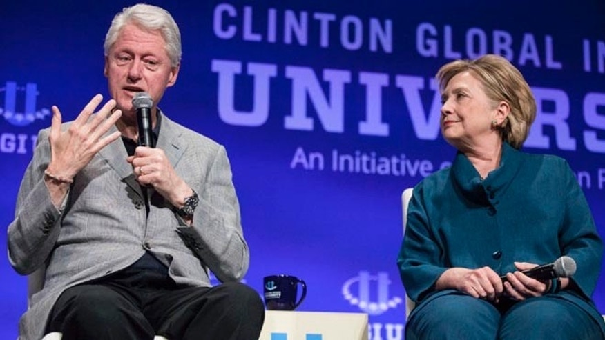 Former President Bill Clinton and former Secretary of State Hillary Clinton at the 2014 Meeting of Clinton Global Initiative University at Arizona State University in Tempe March 22, 2014.