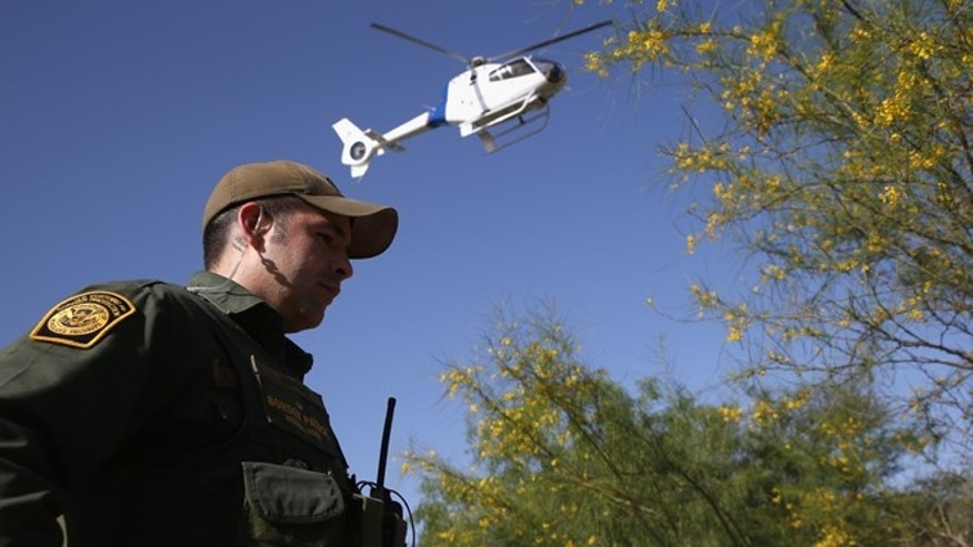 A U.S. Border Patrol agent along the Rio Grande River on April 11, 2013 in Mission, Texas. (Photo by John Moore/Getty Images)
