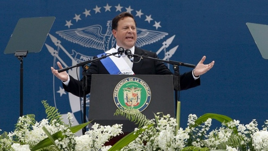 Panama's President Juan Carlos Varela delivers his speech after his swearing in ceremony as new president in Panama City, Tuesday, July 1, 2014. President Varela was sworn in at the Rommel Fernandez National Stadium before thousands of supporters and promised to introduce price controls on basic food products, which was a linchpin of his presidential campaign. (AP Photo/Arnulfo Franco)