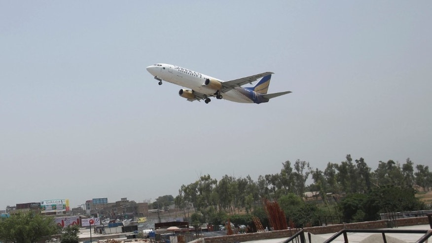 FILE: June 2014: A commercial airplane leaves Bacha Khan airport in Peshaswar, Pakistan.