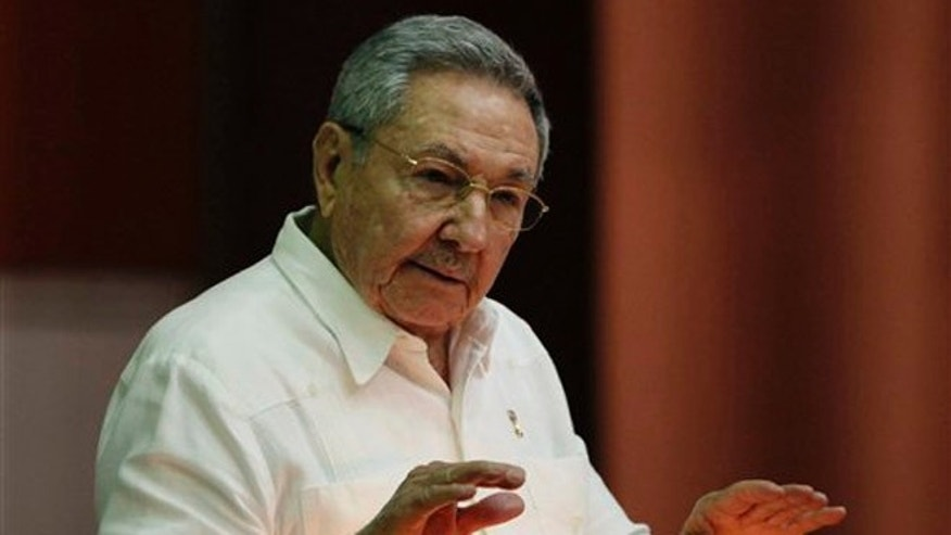 Cuba's President Raul Castro delivers his speech during closing of the third regular session of the eighth legislature, at the National Assembly in Havana, Cuba, Saturday, July 5, 2014. (AP Photo/Cubadebate, Ismael Francisco)