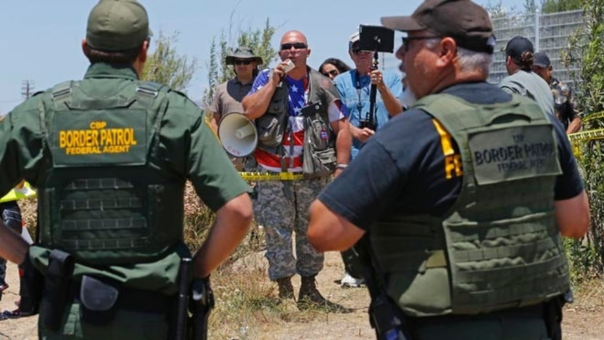 Border patrol officers during a immigration demonstration outside the Border Patrol facility Friday, July 4, 2014 in Murrieta, Calif.
