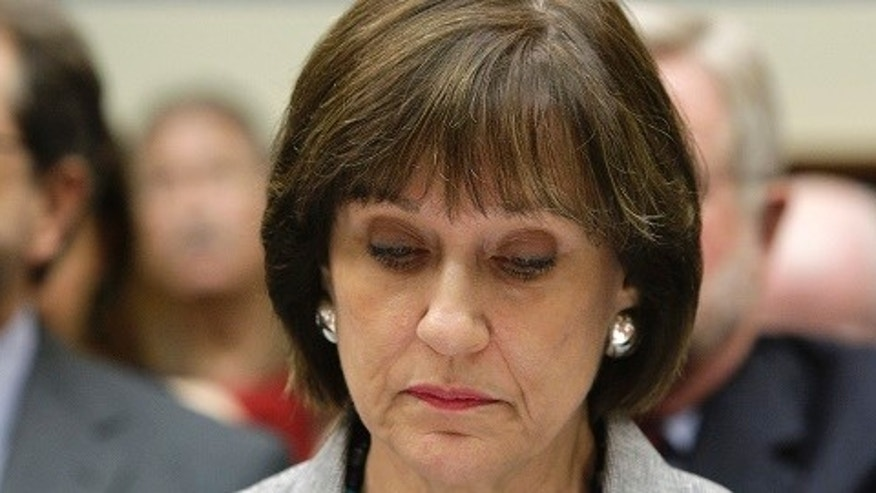 U.S. Director of Exempt Organizations for the Internal Revenue Service, Lois Lerner, takes her seat before a House Oversight and Government Reform Committee hearing on alleged targeting of political groups seeking tax-exempt status by the IRS, on Capitol Hill in Washington, May 22, 2013.  REUTERS/Jonathan Ernst  (UNITED STATES - Tags: POLITICS BUSINESS) - RTXZWJ3
