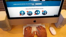 A man looks over the Affordable Care Act signup page on the HealthCare.gov website in New York in this October 2013 file photo.