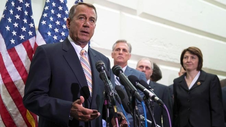 House Speaker John Boehner speaks during a news conference on Capitol Hill in Washington, Wednesday, July 9, 2014.