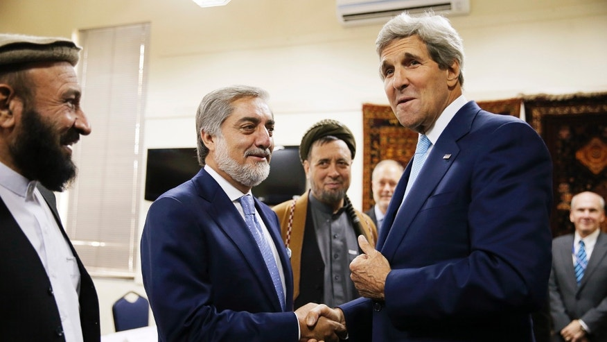 July 11, 2014: U.S. Secretary of State John Kerry shakes hands with Afghan presidential candidate Abdullah Abdullah, center left, at the start of a meeting at the U.S. Embassy in Kabul.