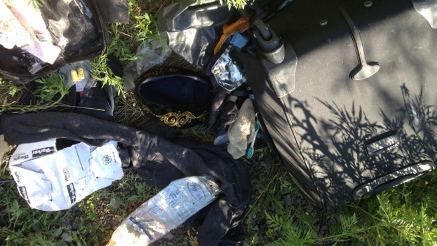 July 20, 2014: A man's looted luggage at the crash site.