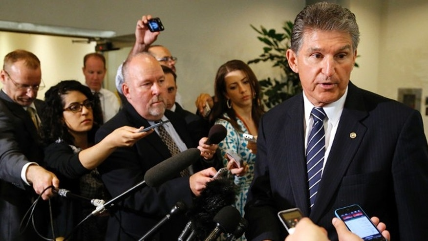 June 10, 2014: Senator Joe Manchin, D-W. Va., speaks to reporters outside of a closed-door Senate Armed Services Committee briefing on the Bergdahl prisoner swap at the U.S. Capitol in Washington.