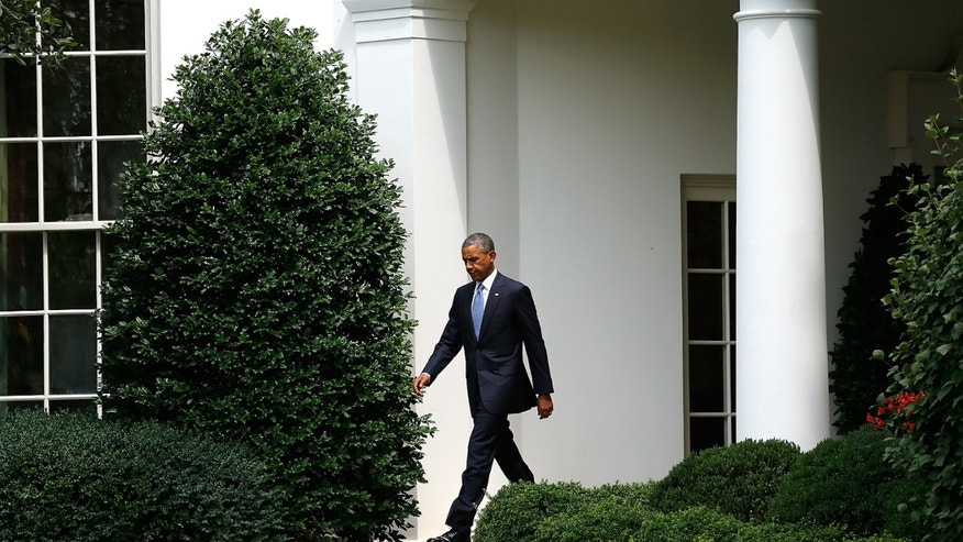 WASHINGTON, DC - JULY 21:  U.S. President Barack Obama walks from the Oval Office to speak on the Ukraine situation outside the White House July 21, 2014 in Washington, DC. Obama urged Russian President Vladimir Putin to compel Ukrainian separatists to cease their efforts of hindering investigators at the site of last week's Malaysian Airlines disaster.  (Photo by Win McNamee/Getty Images)